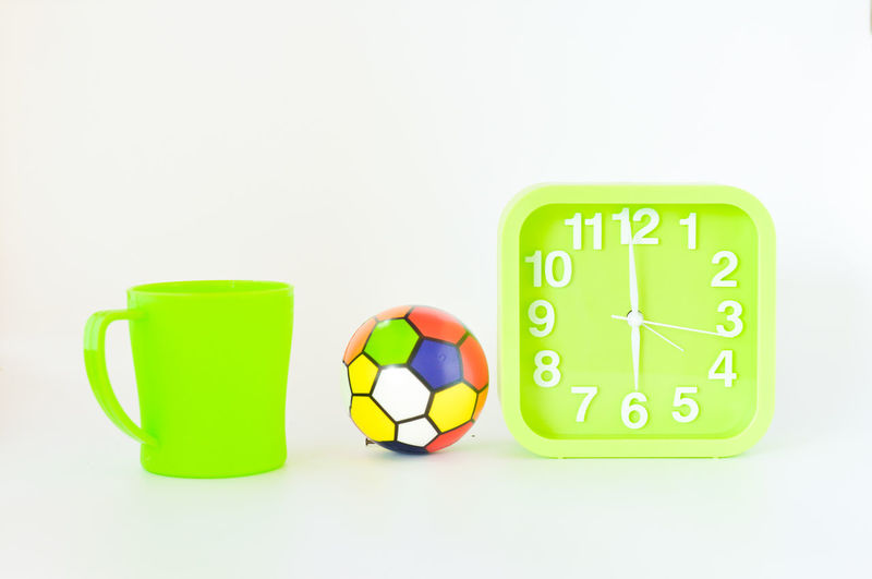 Close-up of green objects against white background