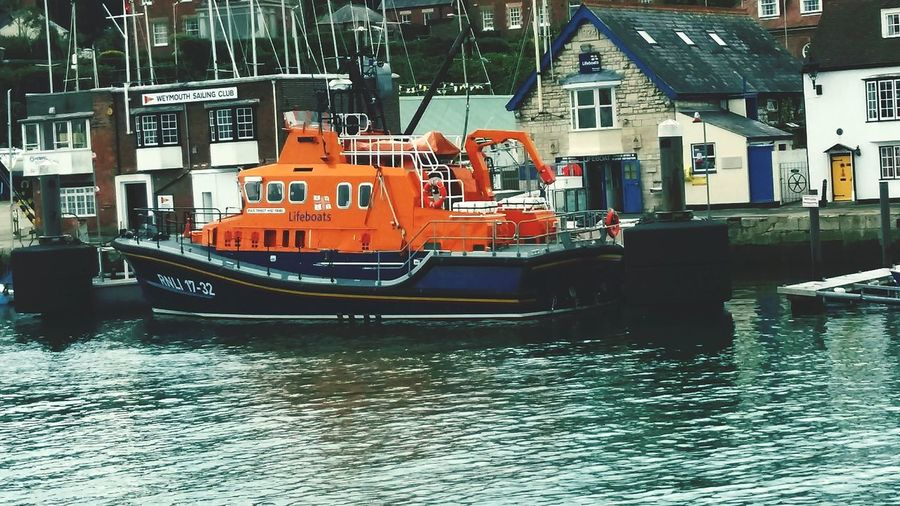 RNLI Lifeboat Water Nautical Vessel Building Exterior Architecture Canal No People Built Structure Waterfront Travel Destinations Moored Day Rescue Rescue Service Charity Life Saving Boat Orange Blue Outdoors City