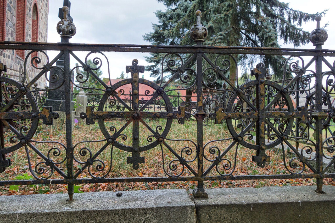 metal, gate, no people, day, fence, architecture, barrier, wrought iron, closed, railing, safety, boundary, security, protection, built structure, nature, outdoors, iron - metal, entrance, pattern, iron