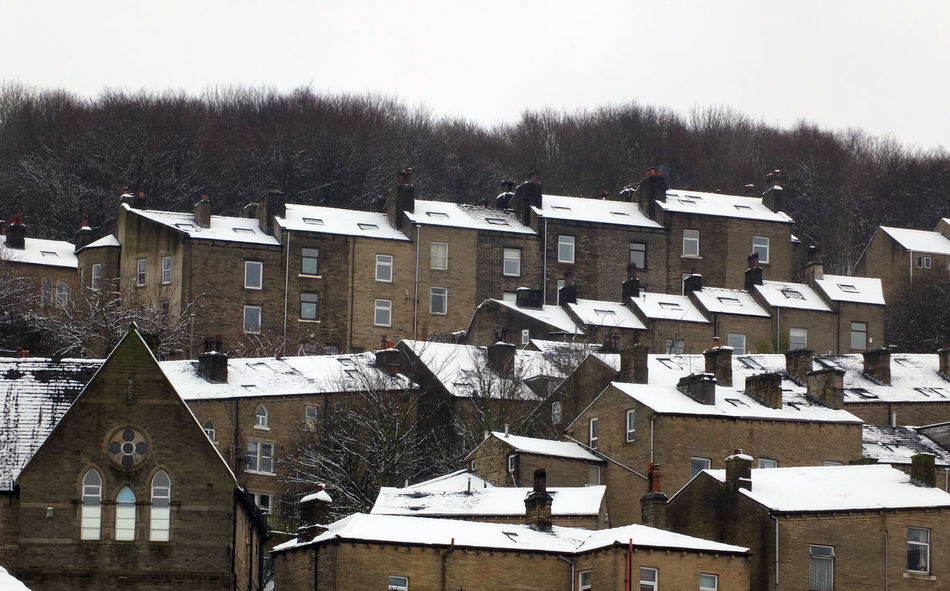 snow on the roofs of terraced houses in hebden bridge Hebden Bridge Architecture Bare Tree Building Exterior Built Structure Cold Temperature Day House Nature No People Outdoors Residential Building Roof Sky Snow Tree Winter
