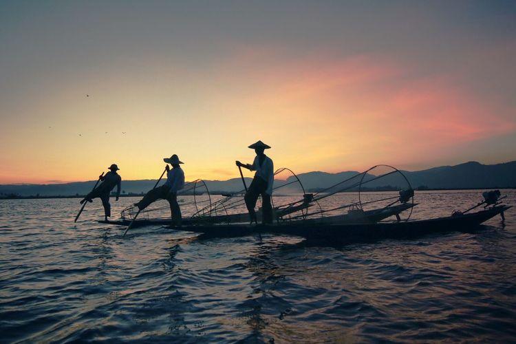 Fisherman at Inle Myanmar Fishermen's Life Boat Fisherman Sunset Background Inle Myanmar Lake Heritage Tredition Cultures Scenics - Nature Beauty In Nature Men Beach Nature Silhouette Orange Color Activity Fishing Fishing Net Waterfront Fisherman