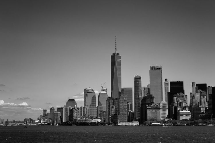 Manhattan downtown skyline from Manhattan bay. Financial District  Manhattan New York City Skyline USA Architecture Black And White Blackandwhite Building Exterior Built Structure Business Finance And Industry City Cityscape Downtown District Freedom Tower No People Outdoors Skyscraper Urban Landscape Urban Skyline