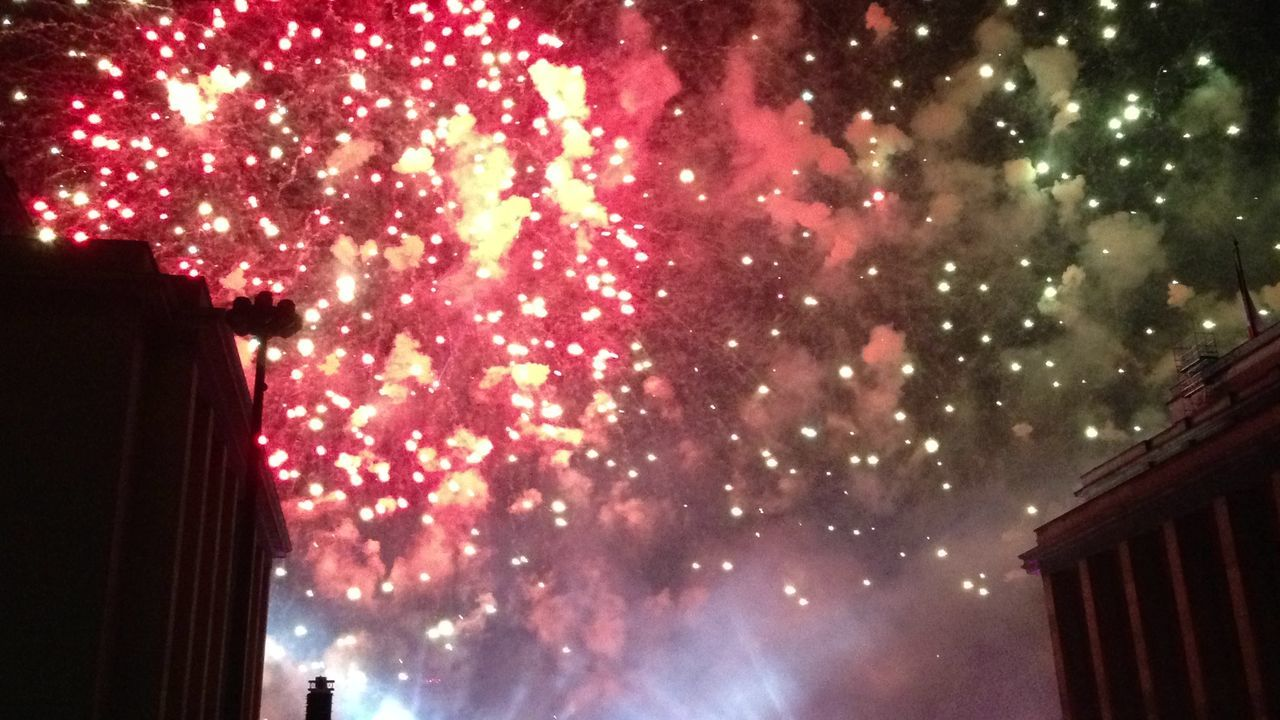 night, illuminated, low angle view, celebration, architecture, building exterior, no people, firework display, outdoors, built structure, sky, city