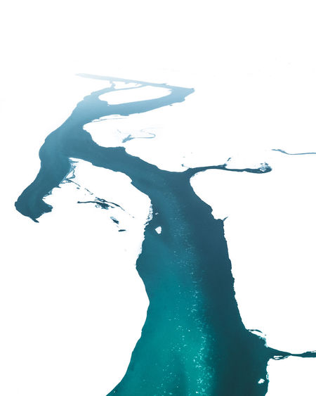High angle view of silhouette man over sea against white background