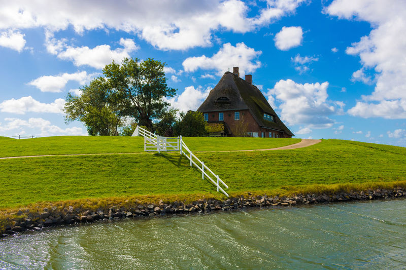 No People Grass Green Color Outdoors Day Tree Architecture Cloud - Sky Hallig House Traditional Culture High Dynamic Range Water Sunny Blue Sky Nordsee Nordfriesland