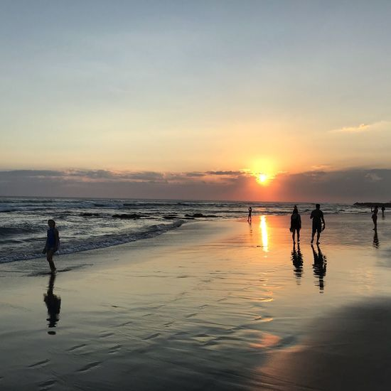 "The day says: ""Goodbye!"" Canggu INDONESIA Bali Sunset Sky Water Beach Real People Beauty In Nature Sea Land Reflection Orange Color Leisure Activity Scenics - Nature Lifestyles Men Nature Child Full Length Women People Outdoors"