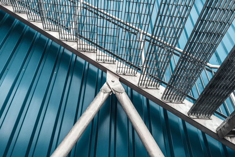 The Architect - 2018 EyeEm Awards Alloy Architecture Blue Built Structure Close-up Connection Galvanised Iron Low Angle View Metal No People Railing Security Shadow Silver Colored Staircase Steel Steps And Staircases Sunlight
