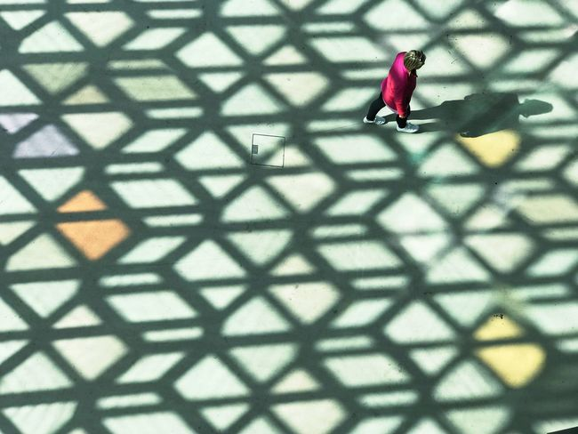 The Street Photographer - 2018 EyeEm Awards The Traveler - 2018 EyeEm Awards The Architect - 2018 EyeEm Awards Visual Creativity Pink Alone Perspective Shapes And Forms Exploring Walking Grid Looking Down Top View Pattern Day Sunlight Shadow Full Length Sunlight High Angle View Metal Lifestyles
