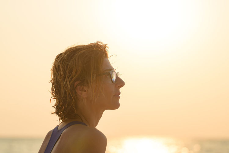 Portrait of woman looking at sunset