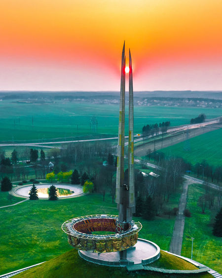 The Mound of glory sunset Sky Architecture Nature Sunset Built Structure No People Grass Plant Building Exterior Environment Outdoors Beauty In Nature Landscape Water High Angle View Travel Destinations Scenics - Nature Day Green Color Tranquility Sahara Dust Sahara Dust Mound Of Glory Mound Glory Minsk Belarus Aerial View Aerial Photography Drone  Eyeofsauron Sauron EyeEm Best Shots