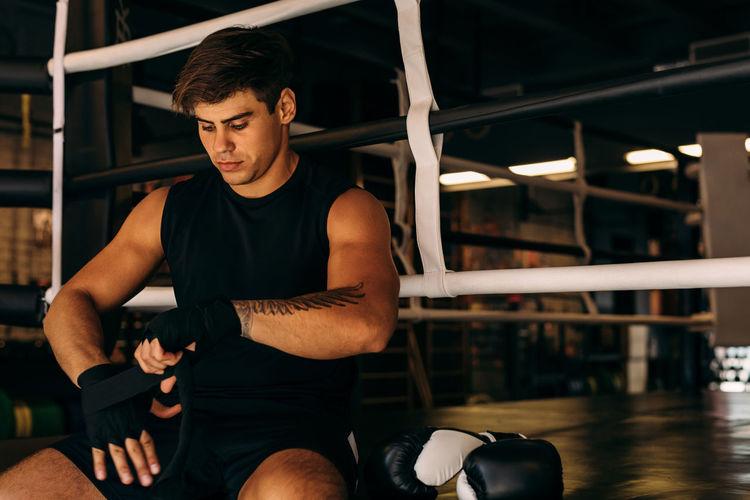 Man preparing for boxing training at health club