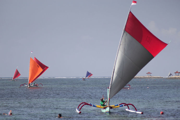 Boat Race : August 22 , 2018 Day Flag Group Of People Horizon Over Water Incidental People Leisure Activity Lifestyles Men Nature Nautical Vessel Outdoors People Pole Real People Red Sailboat Sea Sky Sport Transportation Water