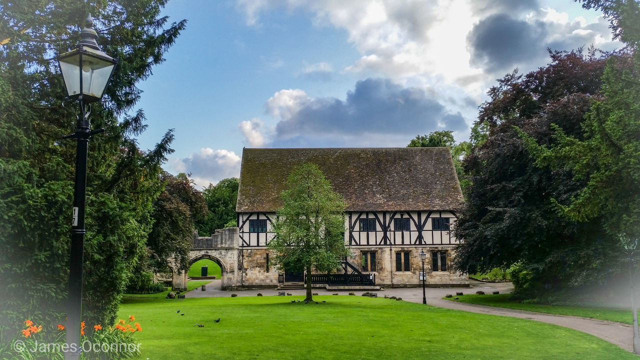 plant, architecture, tree, built structure, cloud - sky, building exterior, nature, grass, sky, green color, day, building, no people, growth, lawn, outdoors, history, the past, garden, beauty in nature, hedge