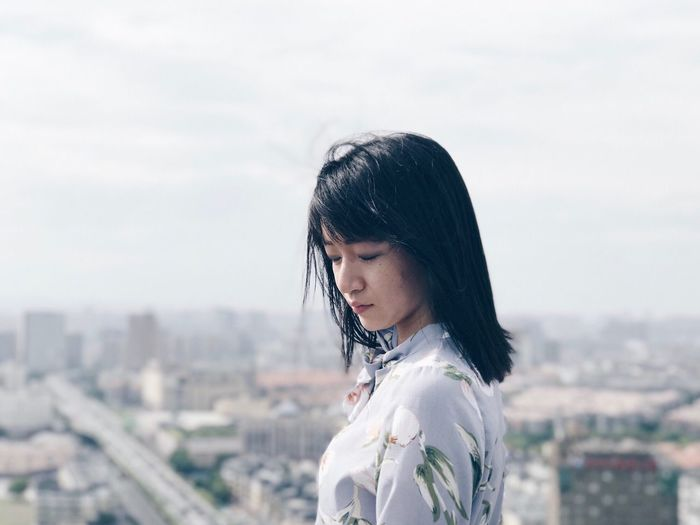 One Person Black Hair Real People Focus On Foreground Architecture Portrait Portrait Of A Woman High Angle View Outdoors
