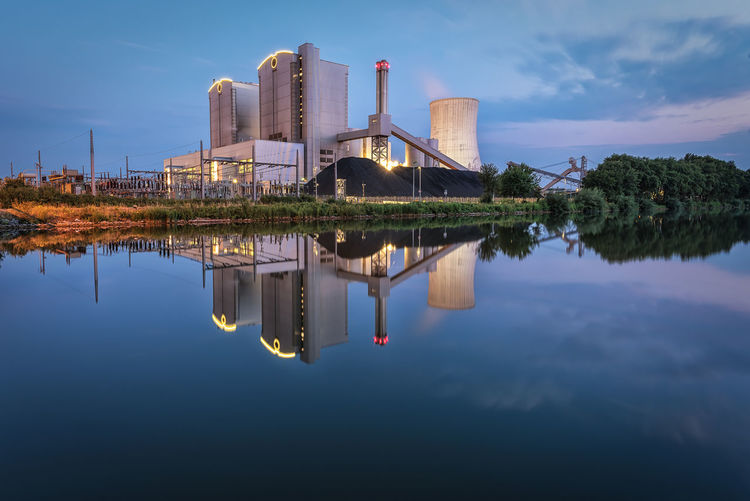 Power plant in Stöcken, Hannover during blue hour in summer Reflection Sky Water Waterfront Architecture Building Exterior Factory Built Structure No People Cloud - Sky Lake Industry Symmetry Smoke Stack Building Outdoors Day EyeEmNewHere Industry Industial Reflection Long Exposure Electical Power Power Plant Hannover