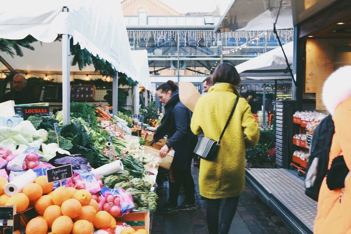 Fresh fruits and vegetables at a marketplace Retail  Customer  Market Choice Freshness Variation Buying Market Stall Incidental People Consumerism Store Casual Clothing Food And Drink Vegetable Holiday - Event Food Abundance Day Choosing Standing