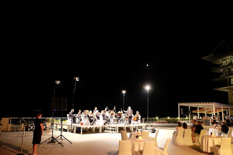 An Evening of Music & Quarter Moon, Sun Gardens Hotel, Orasac Band Black Background Composition Croatia Music Music Production Musical Performance Arts Culture And Entertainment Group Of People Hotel Illuminated Leisure Activity Lifestyles Lighting Equipment Music Equipment Night Orasac Orchestra Orchestral Music Outdoor Photography Real People Sitting Stage Standing Tourism