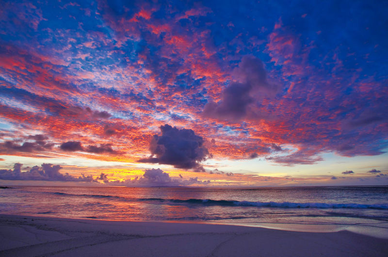 Paradise Beach at the Fiji Islands Fiji Fiji Islands Island Tropic Sky Beauty In Nature Cloud - Sky Scenics - Nature Tranquil Scene Tranquility Land Idyllic No People Nature Outdoors Sunset Water Sea Orange Color Beach Horizon Non-urban Scene Horizon Over Water Dramatic Sky