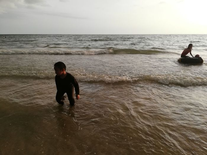 Children enjoy on summer trip 2019,หาดเจ้าหลาว Achi2019 Sea Water Horizon Over Water Horizon Sky Real People Leisure Activity Beauty In Nature Beach Lifestyles Land Waterfront People Nature Motion Men Scenics - Nature Vacations Trip Outdoors