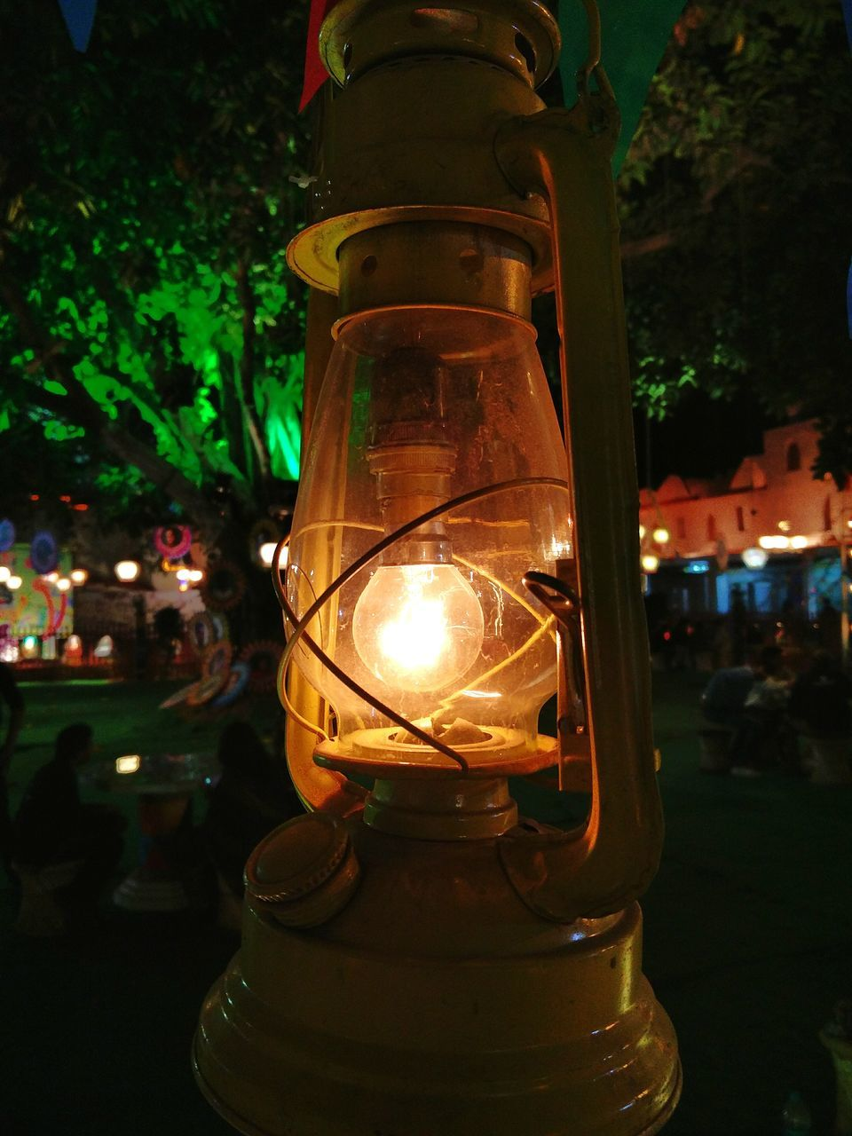 Close-Up Of Illuminated Light Bulb In Oil Lamp At Night