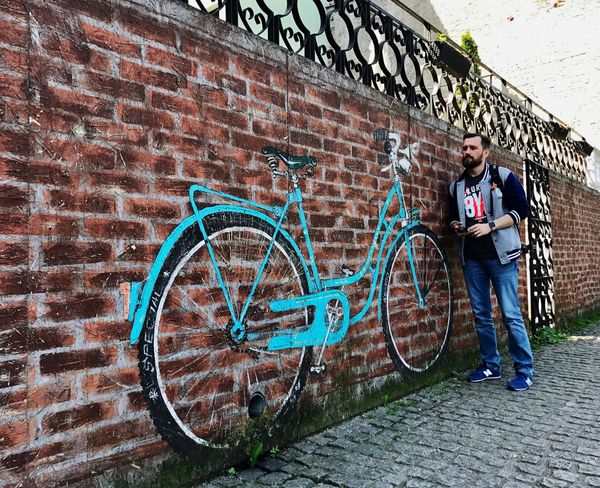 Brick Wall Bicycle One Man Only Full Length One Person Only Men Graffiti Outdoors Casual Clothing Standing Adult Day One Young Man Only Young Adult Street Art Backpack Lifestyles Adults Only Building Exterior Young Men Shotoniphone7plus