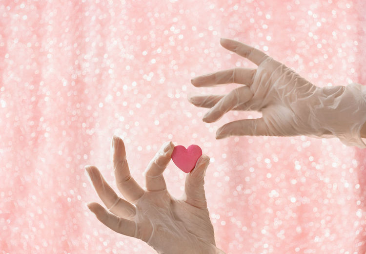 Close-up of woman with pink hands