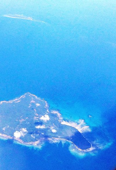 From An Airplane Window Philippines don't know the name of the island, but i'm pretty sure it says Come Here