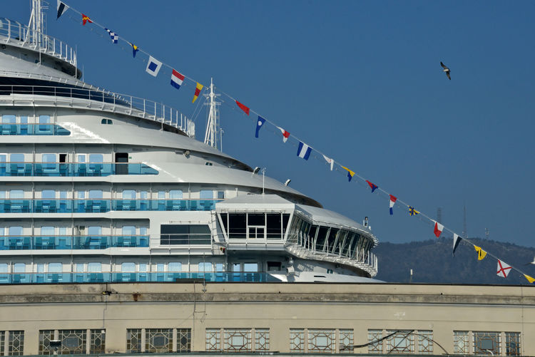 close up of Costa Venezia behind a building of Trieste Cruise Terminal Trieste Costa Crociere Costa Venezia Close Up Flags Lifestyles Luxury Naval Design Transportation No People Low Angle View Passenger Craft Cruise Ship Outdoors Architecture Maritime Photography Balcony Built Structure Clear Sky Day Mode Of Transportation