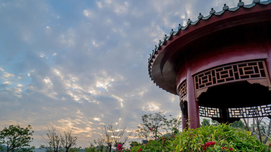 Amusement Park Architecture Arts Culture And Entertainment Building Building Exterior Built Structure Cloud - Sky Day Flower Flowering Plant Growth Low Angle View Nature No People Outdoors Plant Red Sky Tree