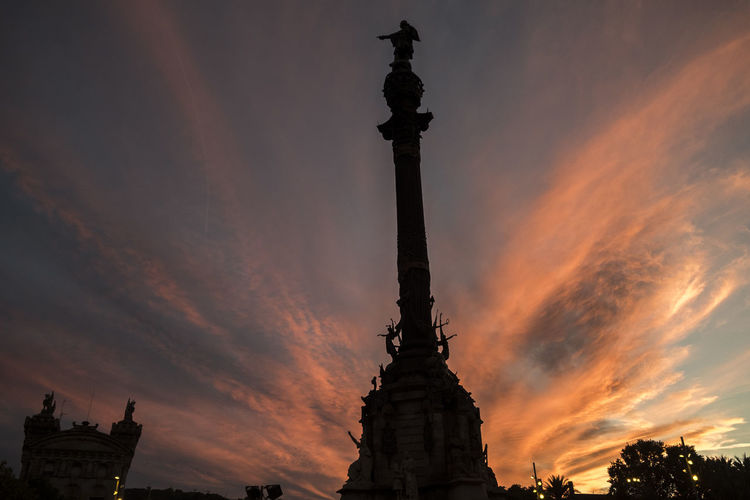 Barcelona Architectural Column Architecture Barcelona Built Structure Capital Cities  Cloud Cloud - Sky Cloudy Dramatic Sky Low Angle View Nature No People Orange Color Outdoors Overcast Sky Sunset Tall - High Tourism Travel Destinations Weather
