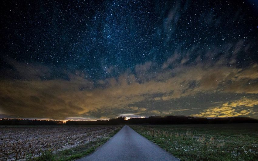 Scenic View Of Road Against Sky At Night