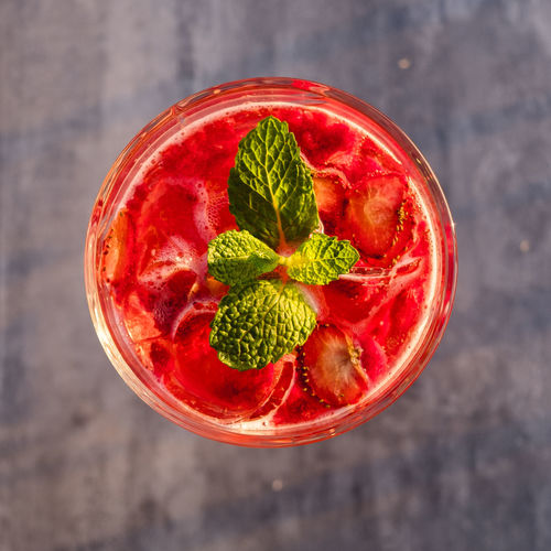 Food And Drink Freshness Red Directly Above Food Healthy Eating Berry Fruit Fruit Strawberry High Angle View Wellbeing Close-up No People Mint Leaf - Culinary Focus On Foreground Still Life Leaf Green Color Drink Ready-to-eat Herb Glass Garnish Temptation