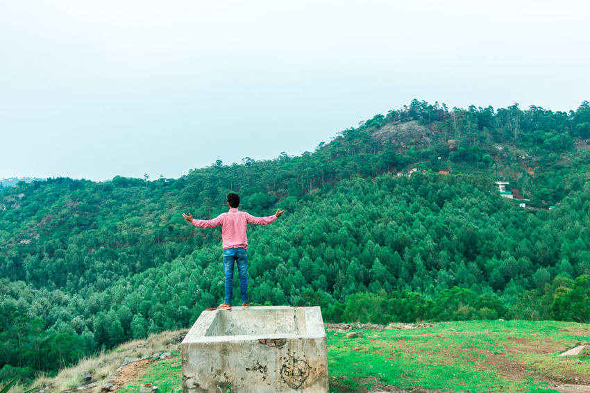 Arms Outstretched Arms Raised Beauty In Nature Casual Clothing Day Forest Freedom Full Length Green Color Human Arm Land Leisure Activity Lifestyles Limb Nature One Person Outdoors Plant Real People Rear View Sky Standing Tree The Great Outdoors - 2018 EyeEm Awards The Traveler - 2018 EyeEm Awards