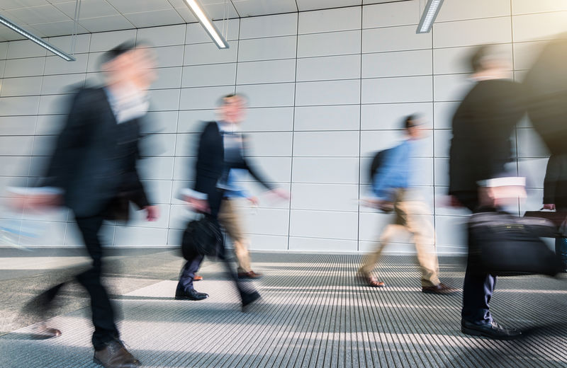 Blurred Motion Of People Walking On Footpath