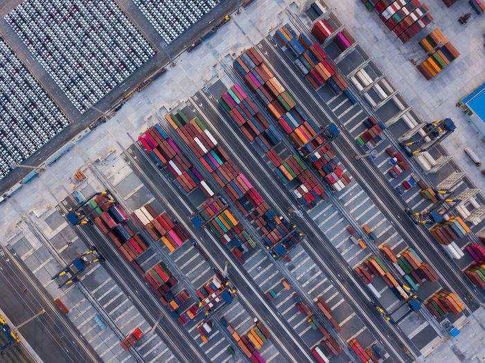 Aerial drone view above containers at dockyard. Professional business logistics and transportation of cargo ship. Aerial View Aerial Aerial Photography Array Business Cargo Cargo Container Cargo Ship Commerce Container Container Ship Container Port Containers Dock Shipping  Shipyard Warehouse Unloading Machinery Industry Harbor Crane - Construction Machinery Row Pattern Export