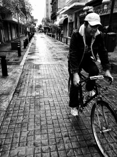 Man on bicycle in city