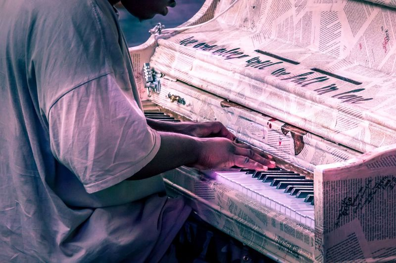 Side view of man playing piano
