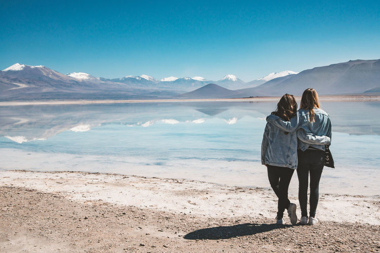 Enjoying the beautiful view at Laguna Blanca. Our first stop in Bolivia! Adult Andes Friends Nature Reflection Tranquility Travel Beauty In Nature Day Friendship Girls Laguna Blanca Lake Mountain Mountain Range Outdoors Salt - Mineral Scenics Sky Sur Lipez Togetherness Tranquil Scene Travel Destinations Two People Water Go Higher This Is Latin America Going Remote Visual Creativity Focus On The Story The Traveler - 2018 EyeEm Awards A New Beginning Human Connection A New Perspective On Life Capture Tomorrow Moments Of Happiness 2018 In One Photograph