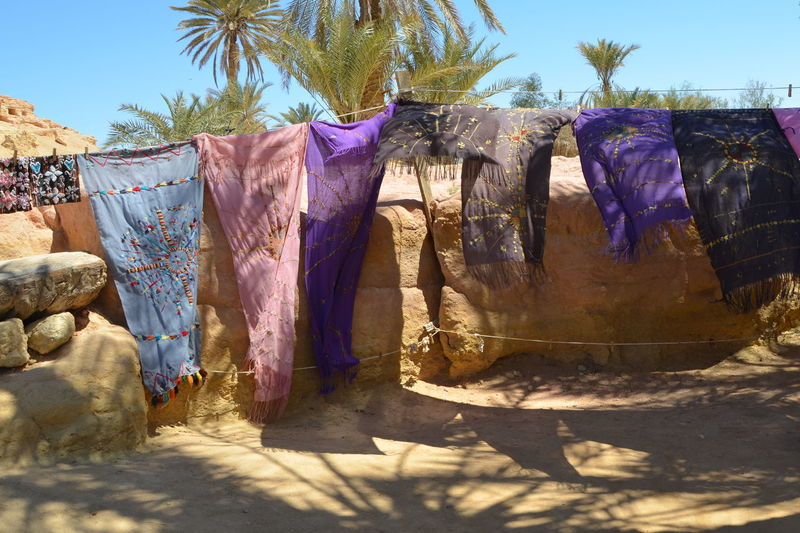 Clothes drying against clear sky on sunny day