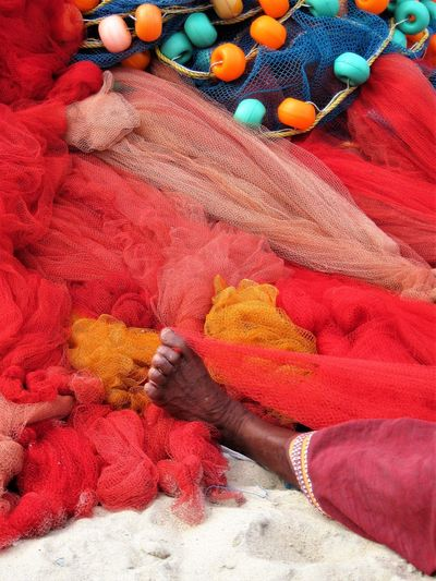 High Angle View Of Woman Among Colorful Textiles