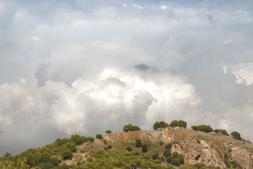 clouds on a hill before a storm Cloud - Sky Sky Scenics - Nature Environment Beauty In Nature Plant Mountain Tranquil Scene Land Landscape Non-urban Scene Rock Outdoors Tree Day Hill