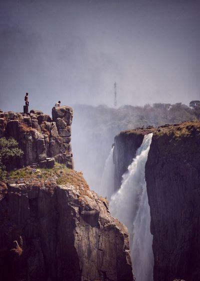 Idyllic shot of waterfall against sky