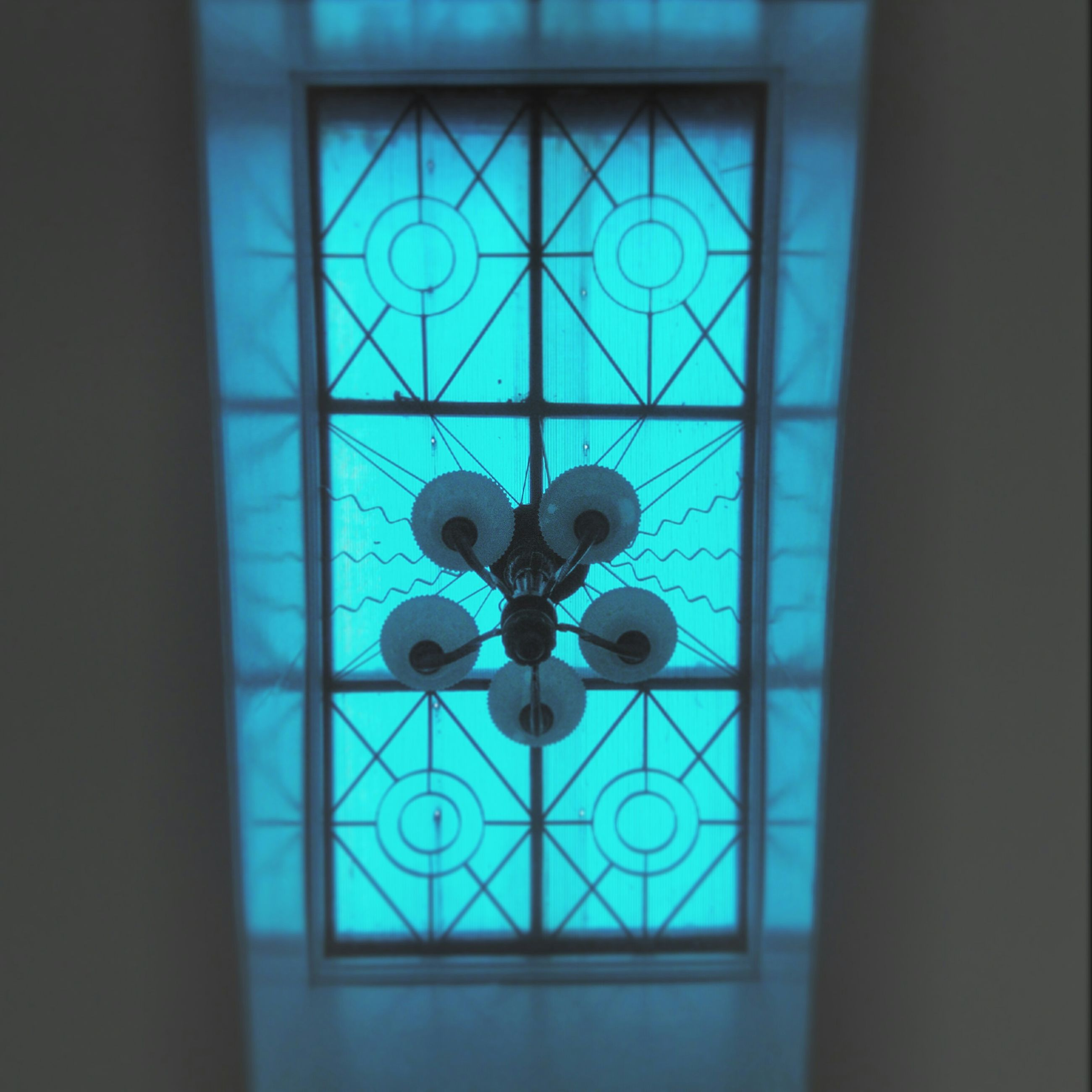 indoors, window, glass - material, geometric shape, transparent, circle, pattern, architecture, built structure, home interior, blue, design, reflection, no people, shape, decoration, day, close-up, ceiling, house