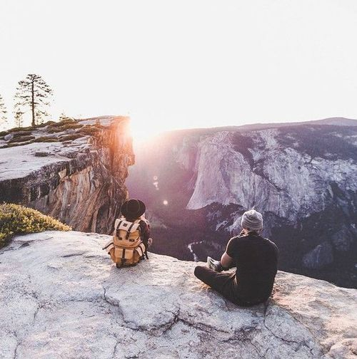 Winter Sitting Sunlight Full Length Snow Adults Only People Leisure Activity Togetherness Cold Temperature Bonding Mature Adult Two People Adult Silhouette Sunset Only Men Outdoors Landscape Day