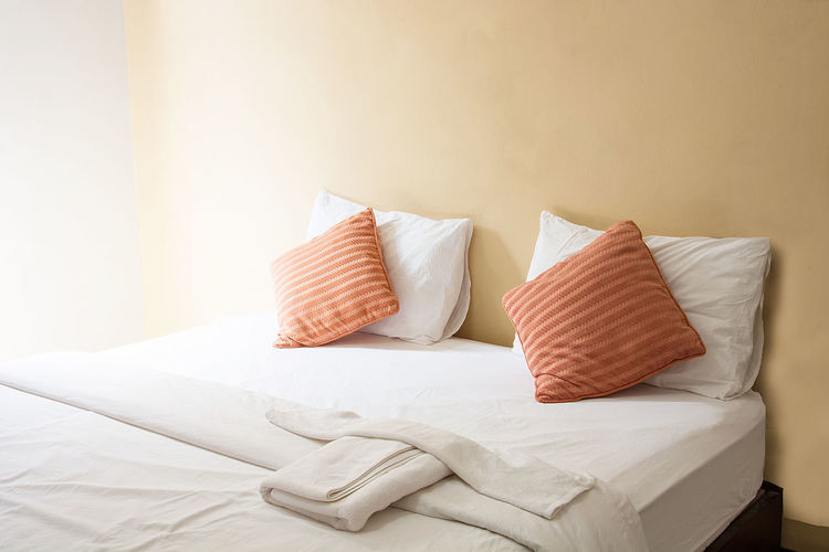 Absence Arrangement Beautiful Bedroom Close-up Comfortable Cushion Domestic Room Empty Fabric Furniture Messy No People Pillow Relaxation Sofa Still Life Textile White