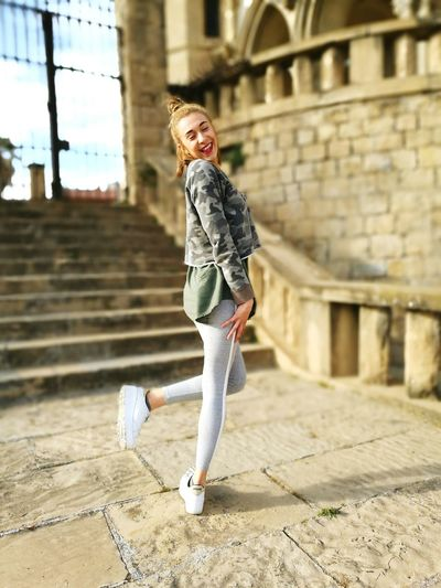 One Woman Only Young Adult One Person Full Length Smiling Beauty Happiness Day Blond Hair Blondehairdontcare Smiling Face Noworries Daytime Natural Beauty Photography Casual Clothing Naturalposer Happy People Happy Hour Churchyard Church Door La Seu _Manresa Stairs Metal Gate Stone Steps