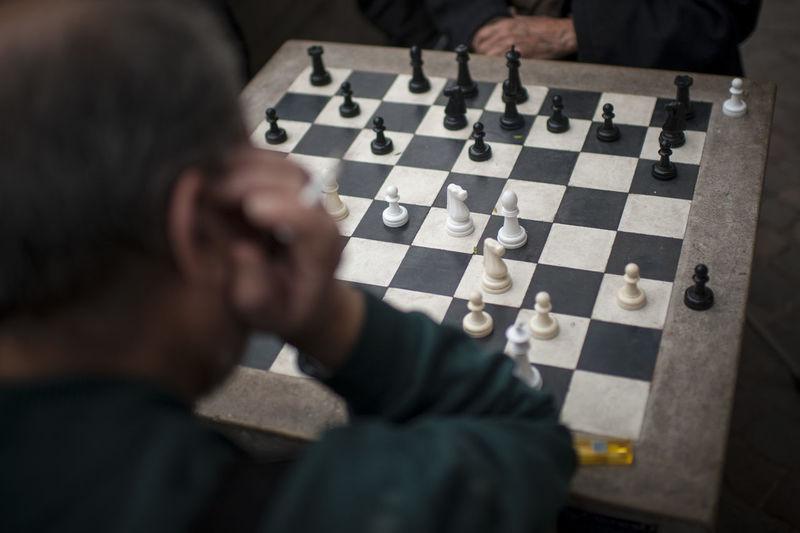 High angle view of man playing chess