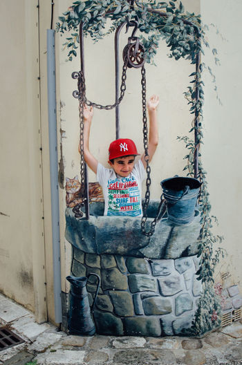 Adult Adults Only Boy Child Childhood Danger Dangerous Day Drop Dropping Falling Full Length Fun Hardhat  Headwear Illusion Indoors  Jump Jumper Jumping One Person People Real People Well  Young Adult