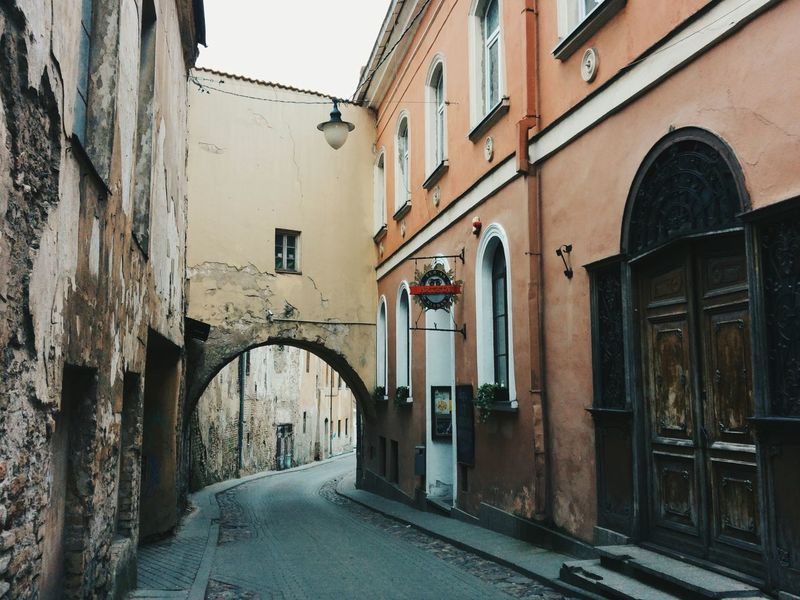 Architecture Built Structure Building Exterior City No People Outdoors Day Road Light And Shadows Arch Old Old Buildings Lonely Travel Destinations Melancholic Enjoying Life Beautiful Hugging A Tree Cityscape Vilnius Colors A Walk In The Woods Hanging Out City Light And Shadow