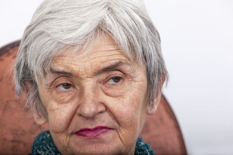 Close-up of senior woman sitting on chair